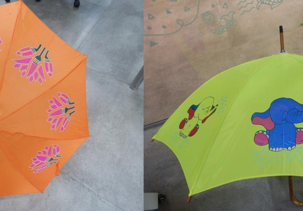 Prepare for a colourful monsoon with umbrella painting